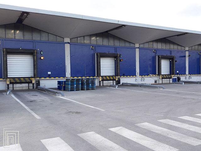 portoni industriali coibentati per baie di carico spiral 50 smart